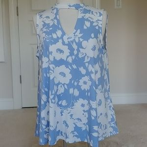 Sleeveless tunic with banded neckline